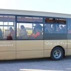 Tour bus heading to UNESCO world heritage site Stonehenge in Wiltshire England
