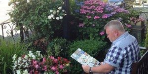many reading morning newspaper in garden of Friars Rest Guesthouse in York