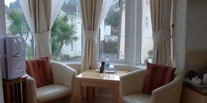 Inside seating with sofas and table at Crown Lodge in Torquay England