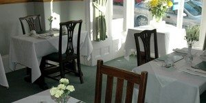 Dining tables and placemats setup at The Lynwood Guesthouse in Penzance
