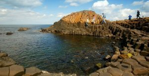 Visitors explore the unique Basalt columns of the Giant's Causeway on a lovely summer day